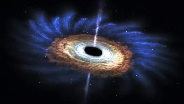Un agujero negro engullendo una estrella